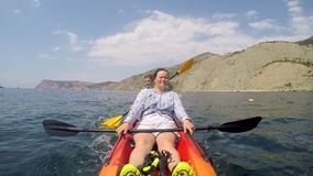 Woman is resting in a kayak stock video