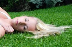 Woman resting on lawn Royalty Free Stock Photo