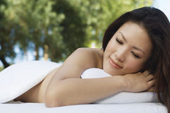 Woman Resting On Massage Table Outdoors Stock Photography