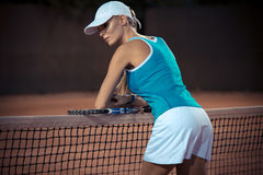 Woman resting after match at tennis court Stock Images