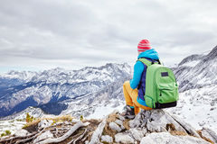 Woman resting on mountain top Royalty Free Stock Photo