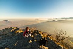 Woman resting on the mountain top Stock Image