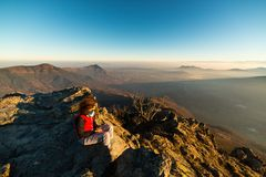 Woman resting on the mountain top Stock Photos