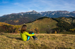 Woman resting in the mountains Stock Image