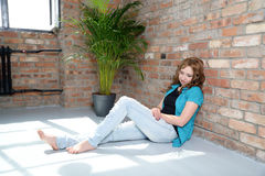Woman resting near the brick wall Royalty Free Stock Photography
