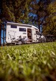 Woman resting near motorhomes in nature. Family vacation travel, Royalty Free Stock Photos