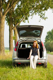 Woman resting in an open car Royalty Free Stock Photos