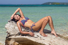 Woman resting over the sea Royalty Free Stock Images