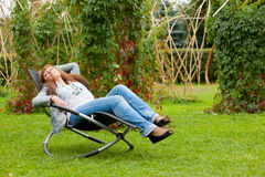 Woman resting in a park Royalty Free Stock Image