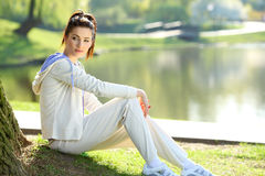 Woman resting in the park Royalty Free Stock Image