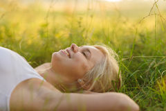 Woman resting in the park. Calm smiling woman resting in the park Royalty Free Stock Images