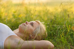 Woman resting in the park. Calm smiling woman resting in the park Stock Photo