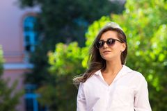 Woman resting at the park. girl in sunglasses, outdoor summer portrait Stock Photos