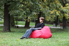 Woman resting in park Stock Images