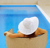 Woman resting at the pool Stock Photos