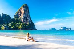 Woman resting on Railay beach Krabi Thailand. Asia. Woman resting on amazing Railay beach in Krabi Thailand. Tropical resort royalty free stock photo