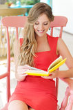 Woman resting and reading favorite book Royalty Free Stock Images