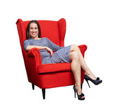 Woman resting on the red chair Royalty Free Stock Photo