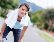 Woman resting while running Royalty Free Stock Image