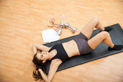 Woman resting between sets at the gym Stock Photo