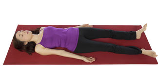 Woman resting in Shavasana Stock Photo
