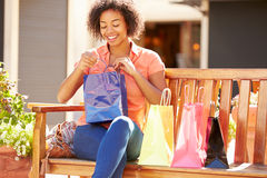 Woman Resting With Shopping Bags Sitting In Mall Stock Image