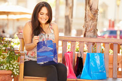 Woman Resting With Shopping Bags Sitting In Mall Stock Photography