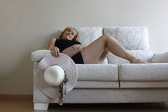 Woman resting on the sofa Royalty Free Stock Photos