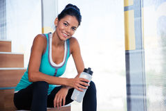 Woman resting on the stairs in gym Royalty Free Stock Photo