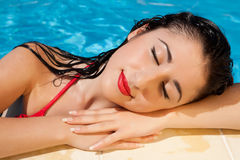 Woman resting after a swim Royalty Free Stock Photo