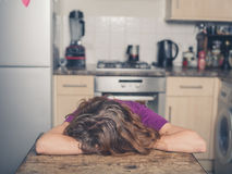 Woman resting at table in kitchen Royalty Free Stock Images