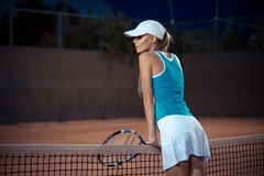 Woman resting at tennis court Stock Photos