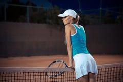 Woman resting at tennis court Stock Photos