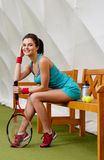 Woman resting after tennis workout Royalty Free Stock Photography