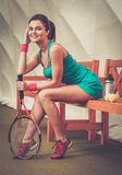 Woman resting  after tennis workout Royalty Free Stock Images
