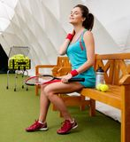 Woman resting after tennis workout Royalty Free Stock Image
