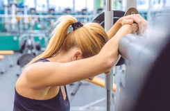 Woman resting tired after lifting barbell on Stock Photography