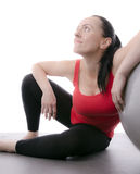 Woman resting after using exercise ball Royalty Free Stock Image