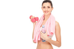 Woman  resting with  water and dumbbell, Royalty Free Stock Photos