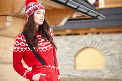 Woman resting after a winter sports on the terrace of the hous Royalty Free Stock Image