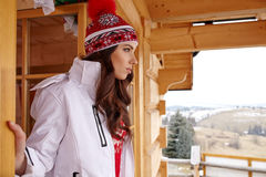 Woman resting after a winter sports on the terrace of the resort Royalty Free Stock Photo