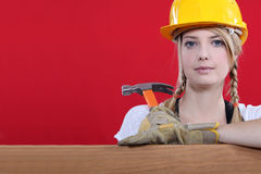 Woman resting on wooden beam Stock Image