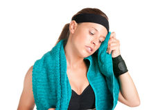 Woman Resting After Workout. Woman resting and cleaning up her face after a fitness workout Royalty Free Stock Images