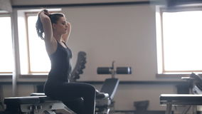 Woman resting after workout at trainers inside gym stock footage