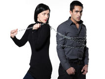Woman restraining a man chained Royalty Free Stock Photos