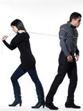 Woman restraining a man chained Stock Photo