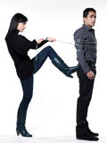 Woman restraining a man chained Stock Photos
