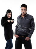 Woman restraining a man chained Royalty Free Stock Photo