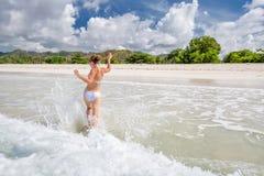 Woman rests at beautiful seashore Royalty Free Stock Photo