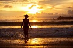 Woman rests at beautiful seashore Stock Photos